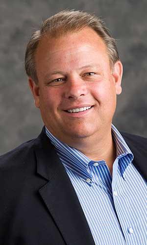 Photo: Chris Burnam, President of StorageMart; Source: Courtesy Photo